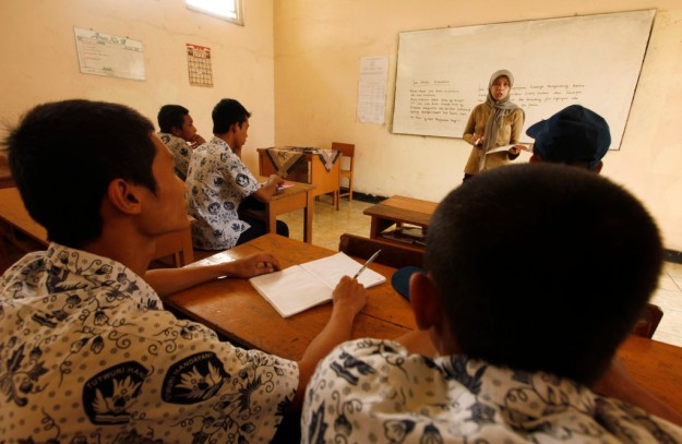 Volunteer teacher Neneng Sulastri conducts art lessons in a juvenile prison for males at Tangerang in Indonesia's Banten province